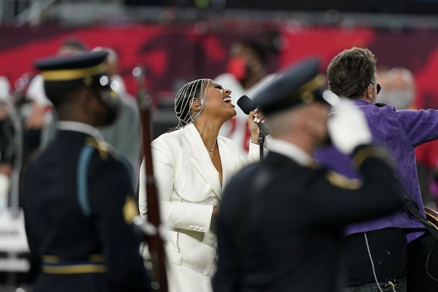 Eric Church, right, and Jazmine Sullivan perform the national anthem before the NFL Super Bowl 55 football game between the Kansas City Chiefs and Tampa Bay Buccaneers, Sunday, Feb. 7, 2021, in Tampa, Fla.