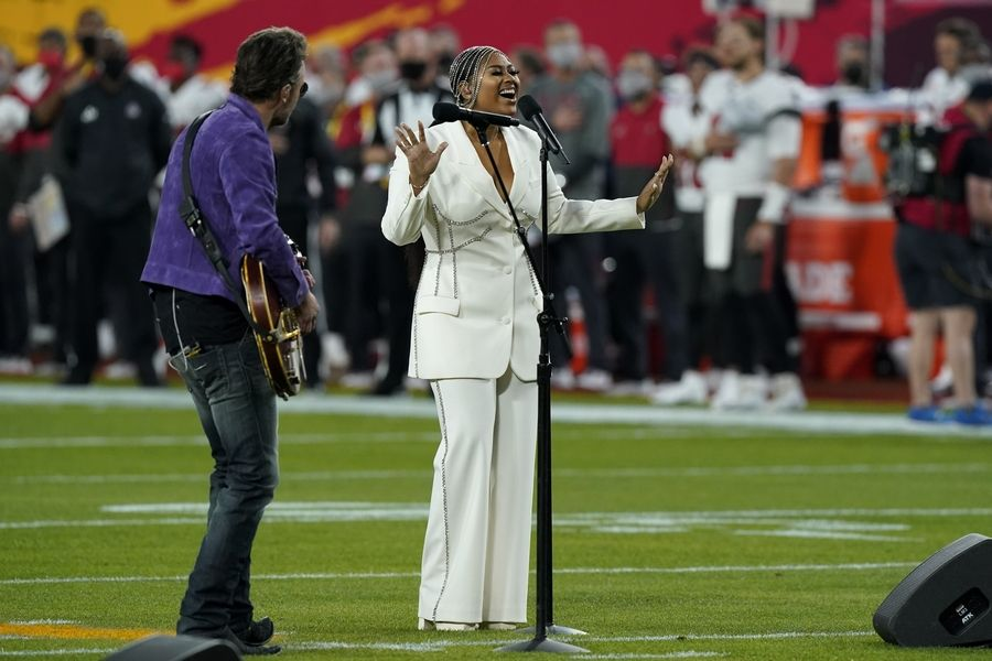 Eric Church and Jazmine Sullivan performs the national anthem before the NFL Super Bowl 55 football game between the Kansas City Chiefs and Tampa Bay Buccaneers, Sunday, Feb. 7, 2021, in Tampa, Fla.