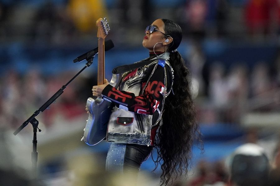 """H.E.R. performs """"America the Beautiful"""" before the NFL Super Bowl 55 football game between the Kansas City Chiefs and Tampa Bay Buccaneers, Sunday, Feb. 7, 2021, in Tampa, Fla."""