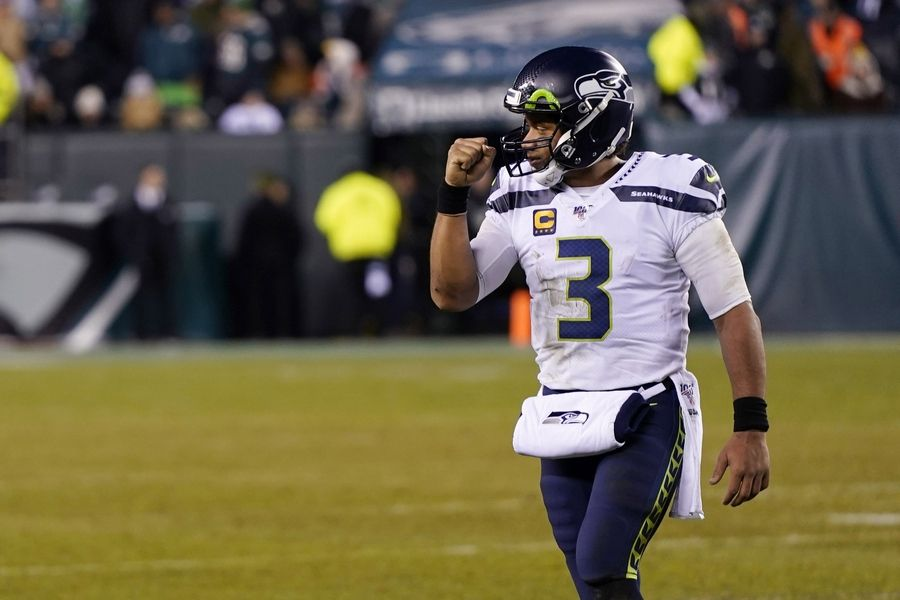 Seattle Seahawks' Russell Wilson reacts during the second half of an NFL wild-card playoff football game against the Eagles, Sunday, Jan. 5, 2020, in Philadelphia. Unfortunately for Bears fans, Wilson, the third-highest paid QB in the NFL, won't be playing for Chicago next year.