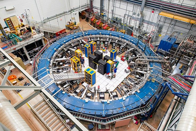 First results from the Muon g-2 experiment at Fermilab have strengthened evidence of new physics. The centerpiece of the experiment is a 50-foot-diameter superconducting magnetic storage ring, which sits in its detector hall amid electronics racks, the muon beamline, and other equipment. This impressive experiment operates at negative 450 degrees Fahrenheit and studies the precession (or wobble) of muons as they travel through the magnetic field.