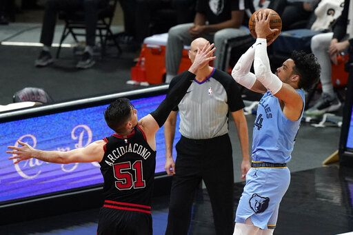 Memphis Grizzlies forward Dillon Brooks, right, shoots against Chicago Bulls guard Ryan Arcidiacono during the second half of an NBA basketball game in Chicago, Friday, April 16, 2021.