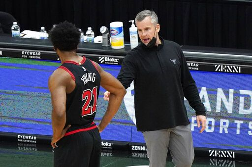 Chicago Bulls head coach Billy Donovan, right, talks to forward Thaddeus Young during the second half of an NBA basketball game against the Memphis Grizzlies in Chicago, Friday, April 16, 2021.