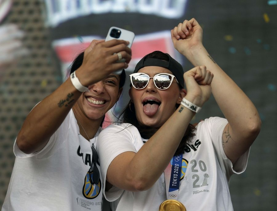 Chicago Sky's Candace Parker (left) and Stefanie Dolson take a selfie at the 2021 WNBA Champion Chicago Sky Rally on Tuesday October 19, 2021 in Chicago at the Pritzker Pavilion.