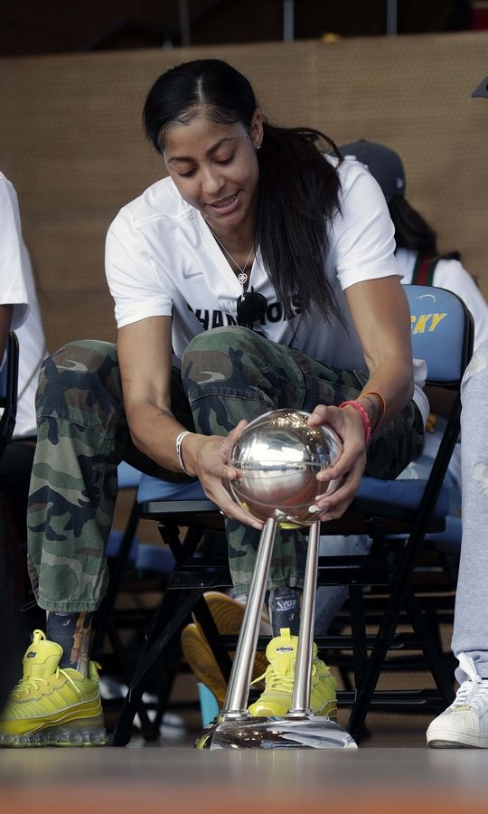 Chicago Sky Forward / Center Candace Parker looks at the trophy at the Pritzker Pavilion during the 2021 WNBA Champion Chicago Sky Rally on Tuesday, October 19, 2021 in Chicago.